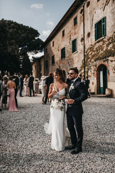 Bride and groom take a moment at Italian black and white wedding