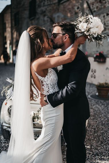 Bride and groom steal a kiss during reception
