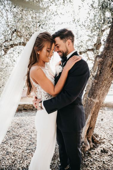 Lace detail wedding dress with groom in tuxedo for black and white wedding in Italy