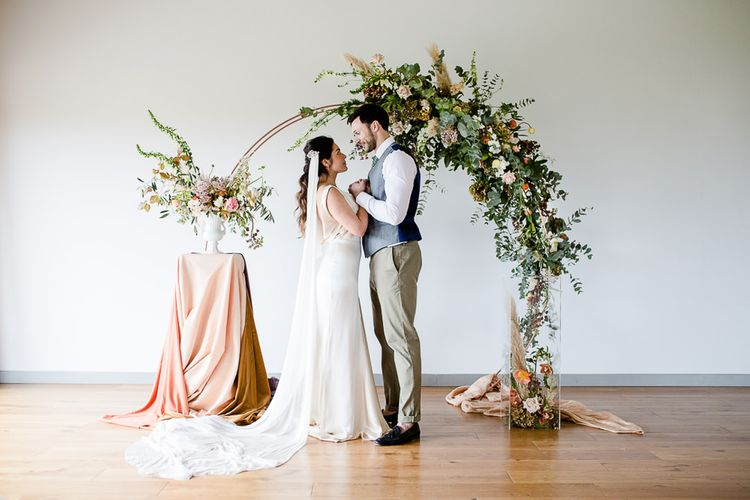 Elegant Pastel Modern Wedding Inspiration With Floral Arch Ceremony Backdrop // Environmentally Conscious Wedding Venue Casterley Barn In Wiltshire Organic Working Farm Stylish Barn Wedding Venue Images Lydia Stamps