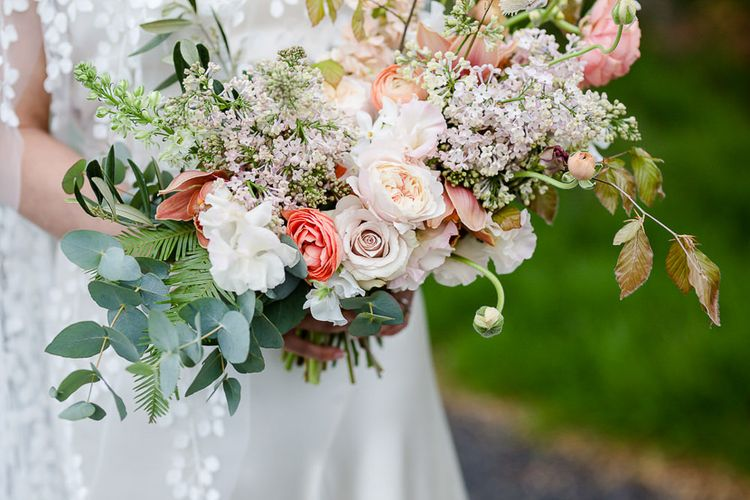 Pastel Wedding Bouquet With Roses // Environmentally Conscious Wedding Venue Casterley Barn In Wiltshire Organic Working Farm Stylish Barn Wedding Venue Images Lydia Stamps