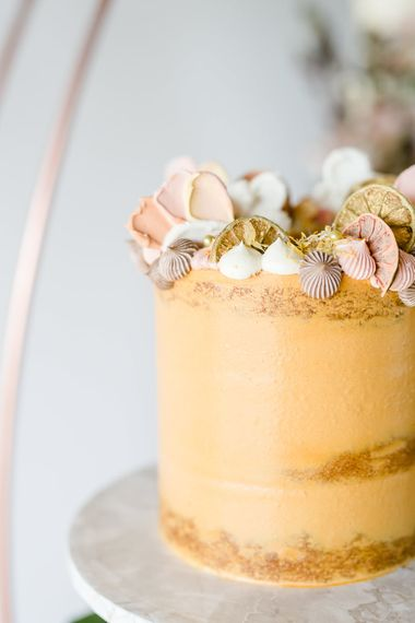Golden Wedding Cake With Shell Details // Environmentally Conscious Wedding Venue Casterley Barn In Wiltshire Organic Working Farm Stylish Barn Wedding Venue Images Lydia Stamps