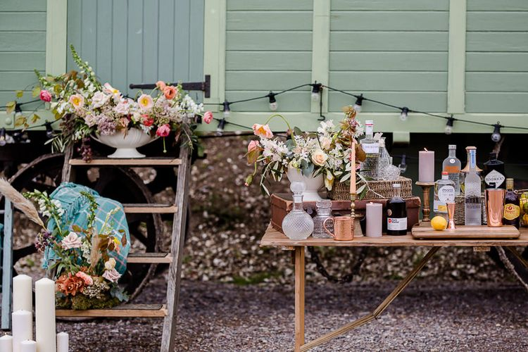 Shepherds Hut Bar For Wedding // Environmentally Conscious Wedding Venue Casterley Barn In Wiltshire Organic Working Farm Stylish Barn Wedding Venue Images Lydia Stamps