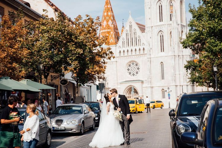 Bride and Groom Kissing in the Street in Budapest