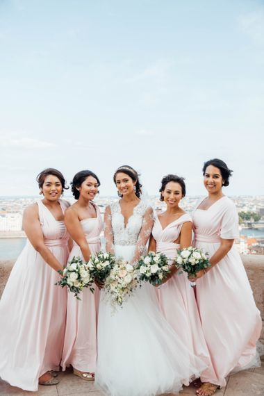 Bridal Party Portrait with Bridesmaids in Pink Multiway Dresses and Bride in Pergola Rosa Clara Princess Wedding Dress