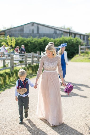 Bridesmaid in Blush Needle & Thread Dress with Page Boy