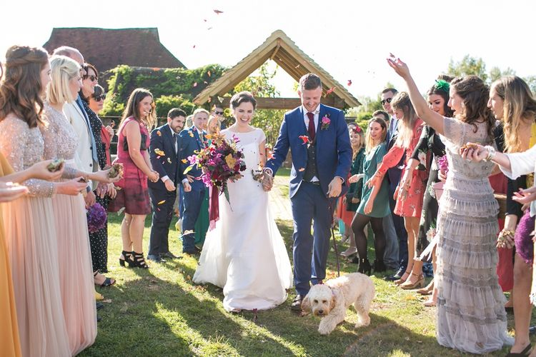 Confetti Moment with Bride in Jesus Peiro Wedding Dress and Groom in Blue  Hugo Boss Suit