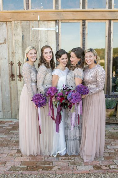 Bridal Party with Bridesmaids in Needle & Thread Dresses and Bride in Jesus Peiro Wedding Dress