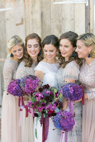 Bridal Party with Bridesmaids in Needle & Thread Dresses,  Bride in Jesus Peiro Wedding Dress Holding Purple Hydrangea Bouquets