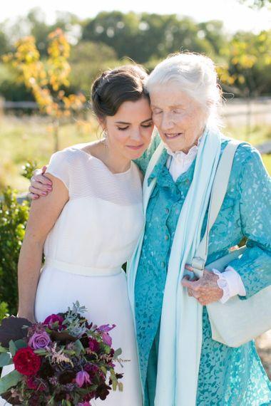 Bride in Jesus Peiro Wedding Dress Hugging Her  Grandmother