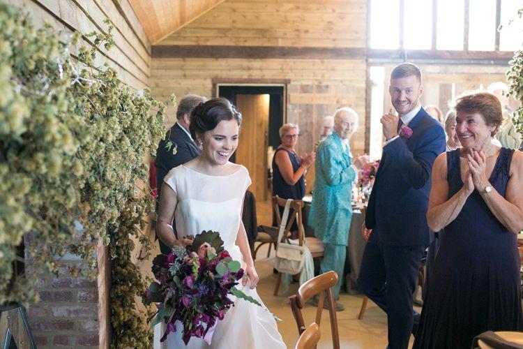 Bride Entering The Wedding Breakfast in a Jesus Peiro Wedding Dress