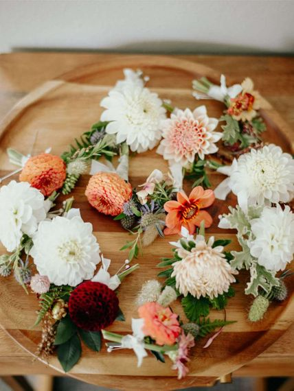 Dahlia buttonholes in peach and white