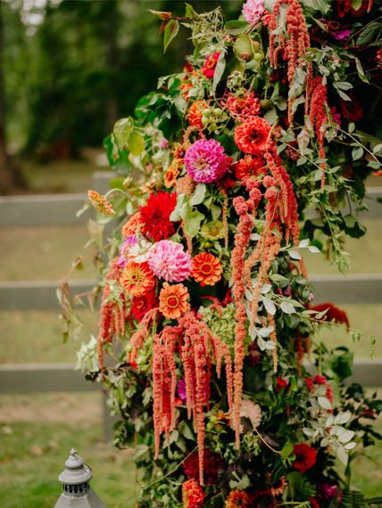 brightly coloured wedding arch flowers