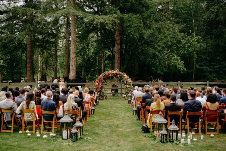 Outdoor wedding ceremony at Mystique Ranch with flower arch