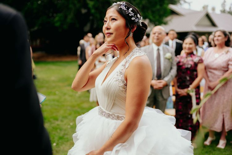 Bride in preloved wedding dress with layered skirt