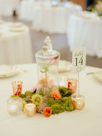 Moss centrepiece with apothecary jar and votives