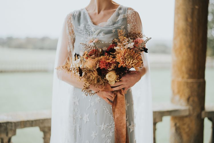 Autumnal wedding bouquet and celestial wedding dress
