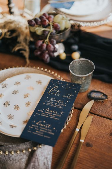 White and gold tableware and on the day stationery menu card