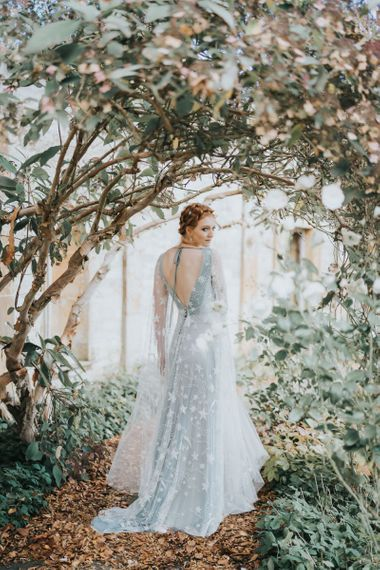 Blue wedding dress with white embroidery celestial details