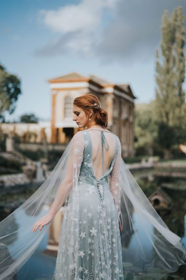 bride in blue celestial wedding dress with white embroidery