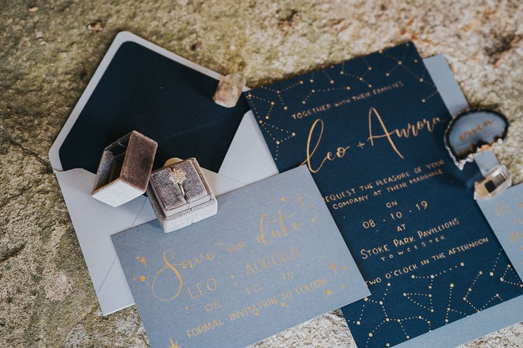 Blue and gold wedding invitation and ring box