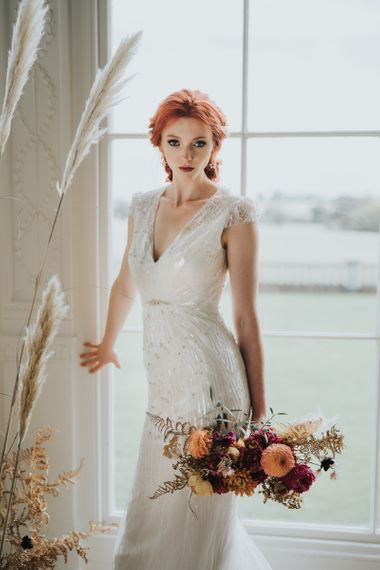 Beaded wedding dress with cap sleeves