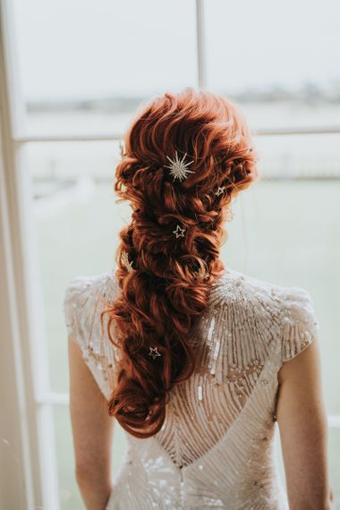 Loose braided wedding hair with celestial clips