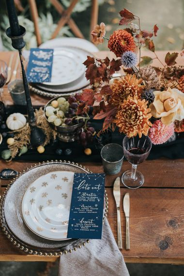 Autumn wedding table decor with celestial menu card