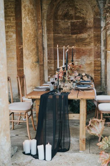Black chiffon table runner, and candles wedding decor