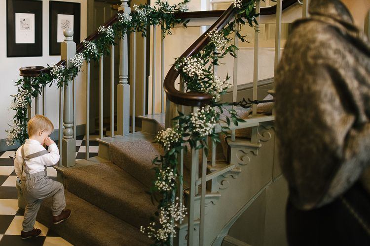 Floral Installations On Staircase // Anna Campbell Embellished Wedding Dress For A Grey, White & Green Classic Wedding At Warwick House With Images By Chris Barber Photography