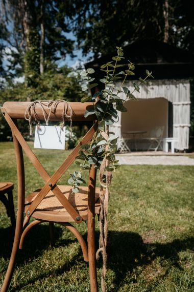 Wedding chair sign at outdoor ceremony for tipi wedding with donut wall and grazing table