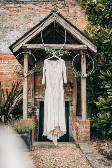 Grace Loves Lace wedding dress with hoop wedding decor