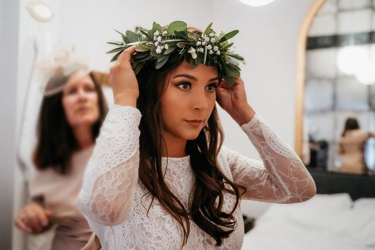 Foliage crown with lace bride dress