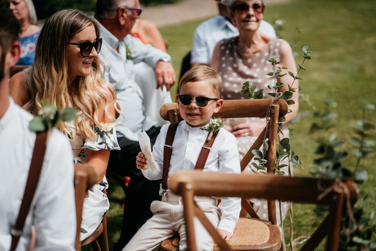 Cute kids at wedding with donut wall and macrame wedding decor