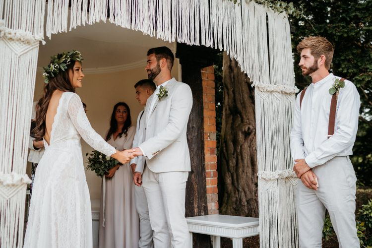 Macrame wedding decor at altar for outdoor ceremony
