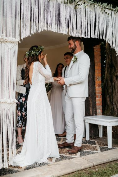 Macrame decor, donut wall and grazing table at outdoor wedding