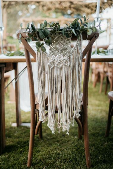 Macrame wedding chair back decor for outdoor wedding with donut wall
