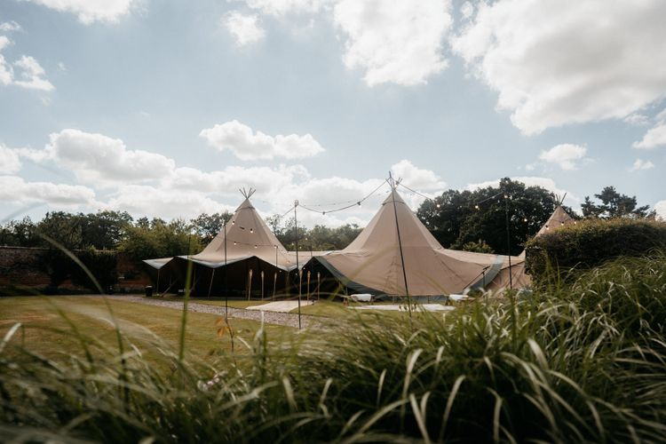 Tipi wedding with donut wall and grazing table