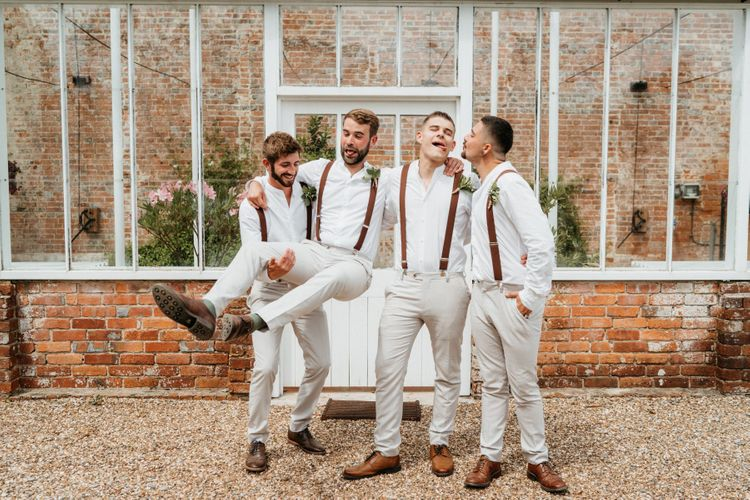 Groom and groomsmen in light coloured trousers with braces