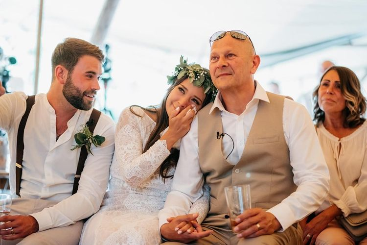 Bride and groom watch father's speech and get emotional