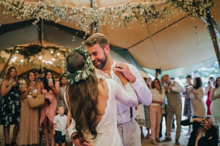 Bride and groom first dance with flower decor and donut wall  tipi wedding