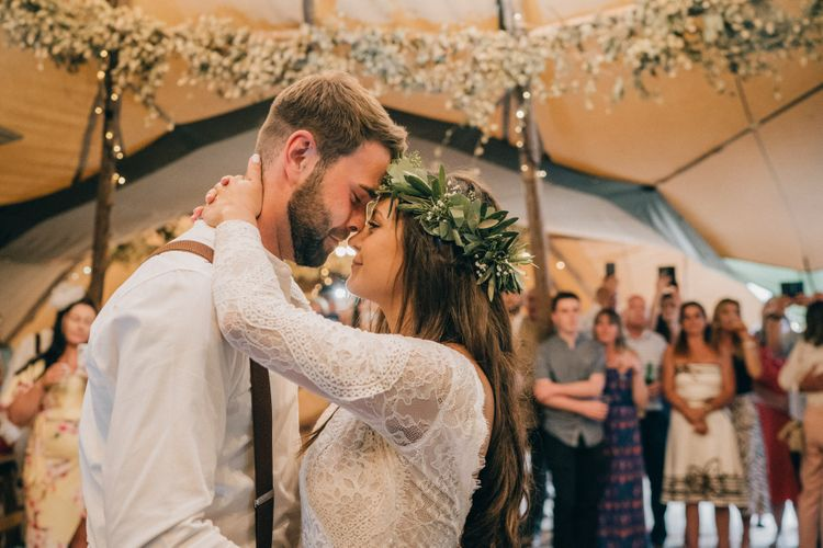 Bride and groom first dance with flower decor and donut wall wedding