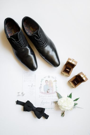 Groom details with illustrated wedding stationery