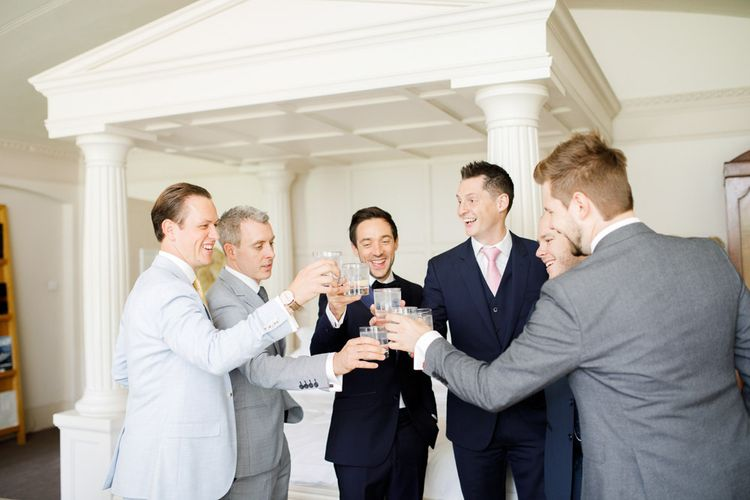 Groom toasts wedding with friends