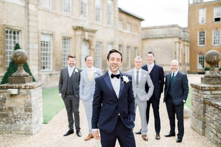 Groom and guests at Aynhoe Park for whimsical wedding