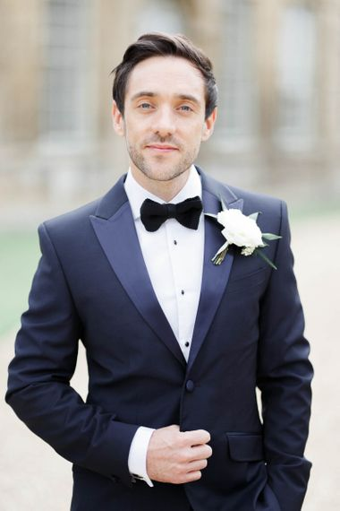 Groom in classic tuxedo with flower buttonhole