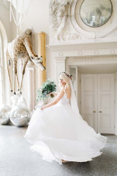 Lace bride dress with bouquet and glitter ball decoration