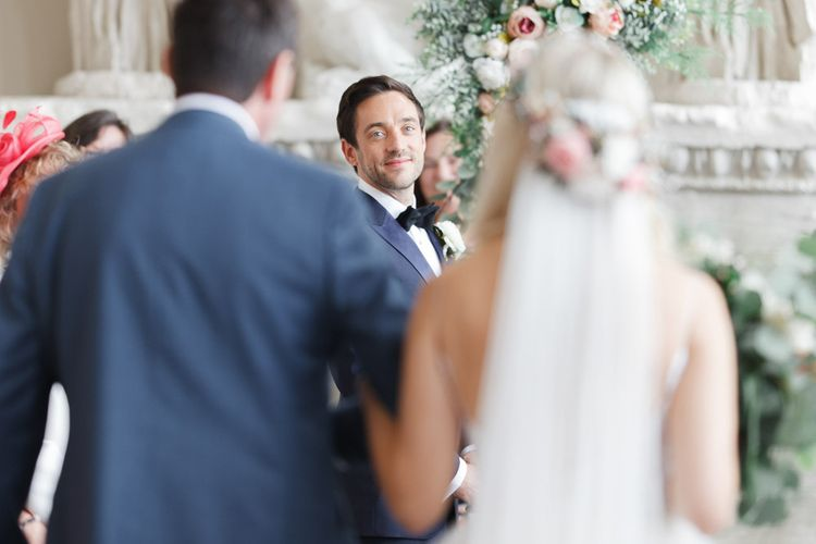 Groom watched bride walk up the aisle at whimsical wedding