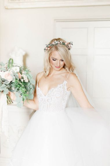 Bride in lace Hayley Paige wedding dress with bouquet and flower crown