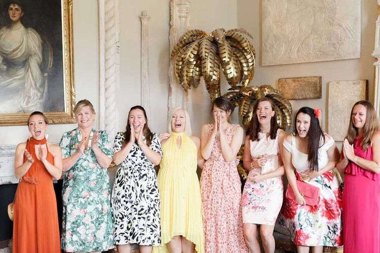 Wedding party sees bride in her lace dress for first time